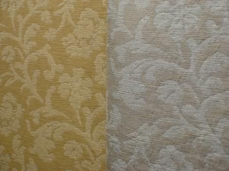Jim Dickens -  Avalon Fabric Collection - Leafy florals patterning two different fabrics which are side-by-side; one in shades of gold, the other in shades of grey