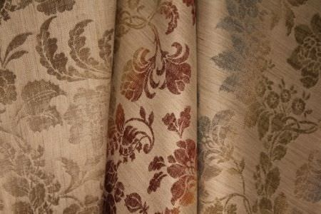 Jim Dickens -  Bohemia Linen Fabric Collection - Fading brown leaves, fading red and orange leaves and fading blue and green leaves on three different folds of cream coloured fabric