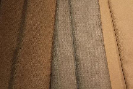 Jim Dickens -  Bohemia Linen Fabric Collection - Folds of plain brown, light blue-grey and warm honey coloured fabrics