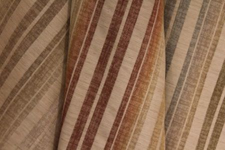 Jim Dickens -  Bohemia Linen Fabric Collection - Striped fabrics in cream, each featuring a different coloured pattern, such as faded brown, blended red and orange, and blue fading to green