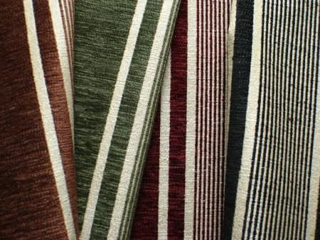 Jim Dickens -  Farnese Fabric Collection - Slightly textured brown, green, burgundy and black stripes patterning four folds of beige coloured fabric