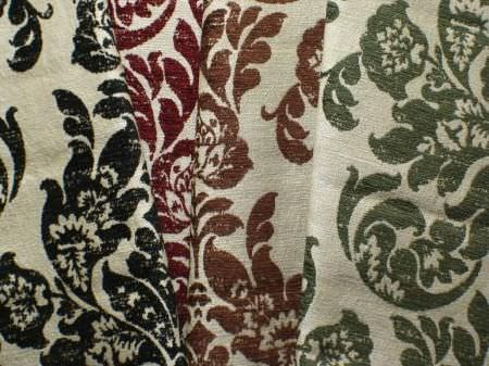 Jim Dickens -  Farnese Fabric Collection - Swatches of 4 fabrics in beige and all with the same large, leafy swirl pattern, but one in black, one in red, one in brown and one in green