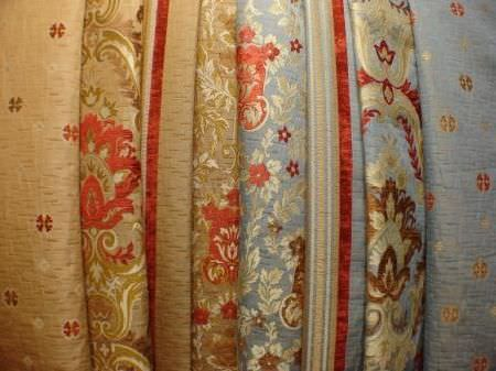 Jim Dickens -  Firenze Fabric Collection - Blue, cream, brown, red and gold patterned and striped fabrics layered over one another