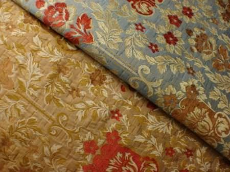 Jim Dickens -  Firenze Fabric Collection - Two fabrics (one in gold and one in light blue), both with a small floral and leaf pattern in cream, red and brown
