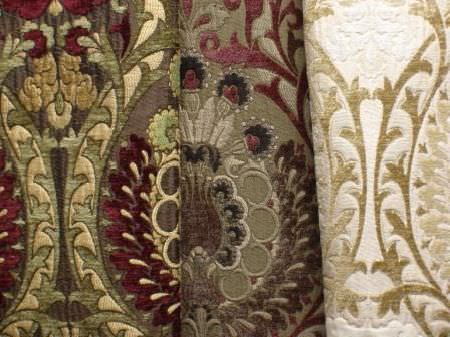Jim Dickens -  Isabella Fabric Collection - Three fabrics, all with the same busy pattern, but one in light cream colours and the other two in dark reds, greens and browns