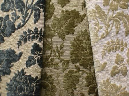 Jim Dickens -  Josephine Fabric Collection - Textured gold, dark green and dark blue leafy, floral patterns onwhite, cream and light green-grey coloured fabric backgrounds