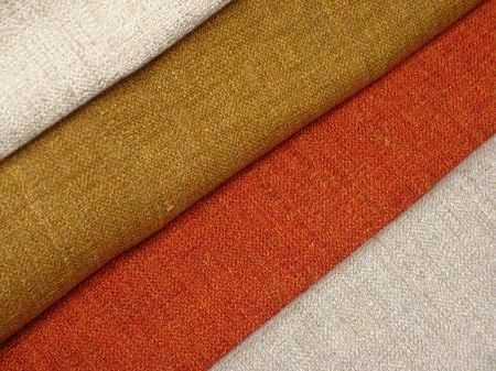 Jim Dickens -  Lecco Fabric Collection - Plain chalk white coloured fabric, plain brown fabric with a hint of gold, plain bright red-orange fabric and plain light grey fabric