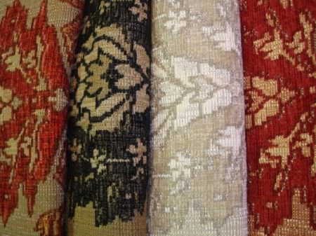 Jim Dickens -  Murillo Fabric Collection - Red and grey, black and beige, grey and white, and red and gold-beige fabrics, all featuring the same pattern
