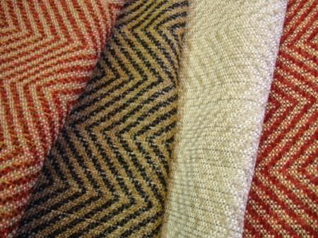 Jim Dickens -  Murillo Fabric Collection - Four fabrics with narrow zigzag patterns in burnt orange and beige, black and gold, grey and cream, and red and beige