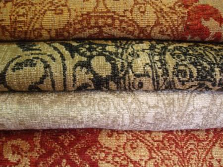 Jim Dickens -  Murillo Fabric Collection - Patterned fabrics in four colour choices;orange-red and gold, black and gold, grey and white, and red and cream-beige