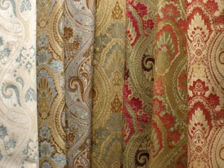 Jim Dickens -  Olympos Fabric Collection - Large, ornate patterns on seven folds of fabric which include colours such as green, red, light blue, white, cream, gold and brown