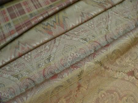 Jim Dickens -  Perugia Fabric Collection - Folds of several different fabrics which have both a very subtle pattern and very subtle multicoloured striped and checked designs