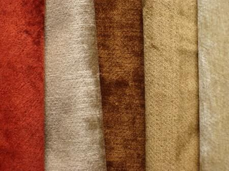Jim Dickens -  Plain Cleaves Fabric Collection - Five folds of plain but slightly textured fabrics in bright terracotta, beige, brown, gold and cream colours