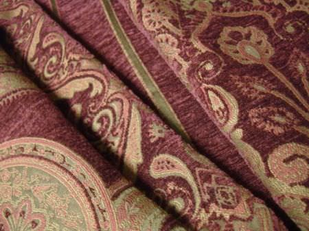 Jim Dickens -  Topkapi Fabric Collection - Pale shades of pink and green making up detailed patterns on folds of purple textured fabric