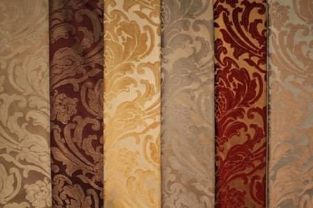 Jim Dickens -  Trafalgar Fabric Collection - Six luxurious patterned fabrics with contrasting textures, in colours including brown, burgundy, gold, cream and silver