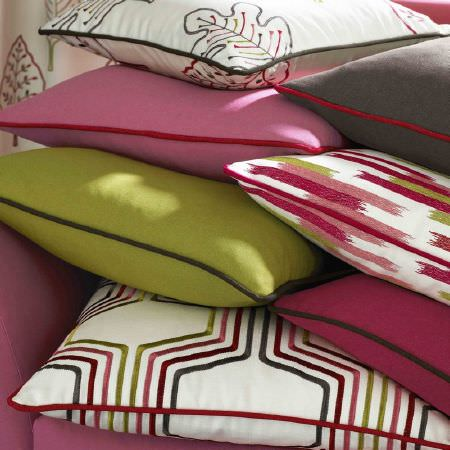 Kai -  Abira Fabric Collection - A stack of cotton cushions in colours of white, green, red, pink and black in plain and embroidered styles