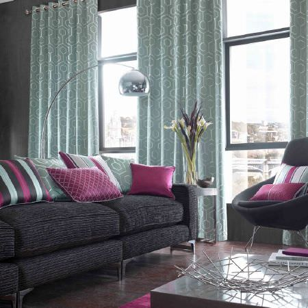 Kai -  Casson Fabric Collection - Cushions in colours of white, purple, grey and black, in plain, geometric and striped styles on brown chairs and sofas in a modern apartment