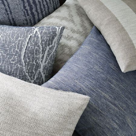 Kai -  Couture Fabric Collection - A group of subtly streaked, striped and patterned scatter cushions in denim blue, beige and light and dark shades of grey