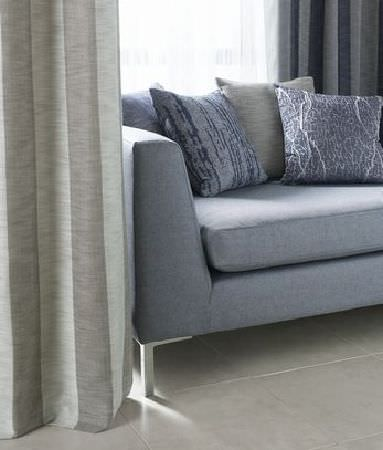 Kai -  Couture Fabric Collection - Beige and pale grey striped curtains with a plain grey sofa and three subtly streaked grey and beige scatter cushions