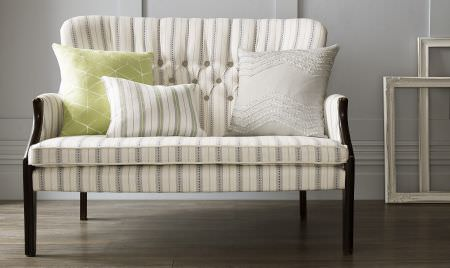 Kai -  Genoa Fabric Collection - Dark wood legs to a white and grey striped sofa, with a striped cushion, a pale grey-white cushion, and a lime green cushion
