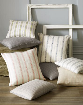 Kai -  Genoa Fabric Collection - Eight striped and checked cushions in light shades of grey, green, blue, pink, cream and white, with two white frames