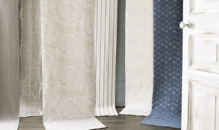 Kai -  Genoa Fabric Collection - Six swathes of fabric featuring subtle patterns and stripes in white, navy blue and pale shades of grey