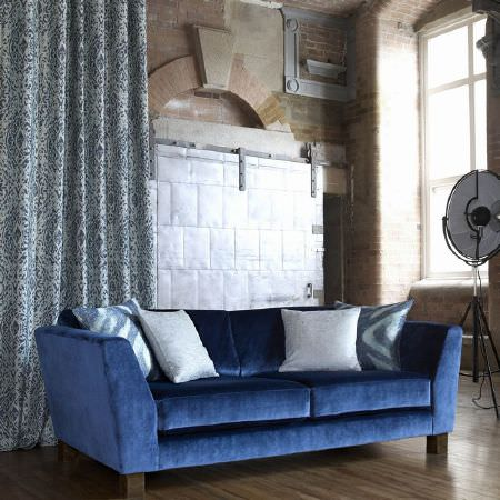 Kai -  Janco Fabric Collection - Large sofa in royal blue velour, with pale blue curtains with a dark blue print, two white cushions and two blue patterned cushions