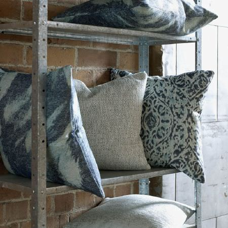 Kai -  Janco Fabric Collection - Metal shelves with two stone effect cushions, 1 cushion patterned with two different shades of blue, and two cushions with blue brushstrokes