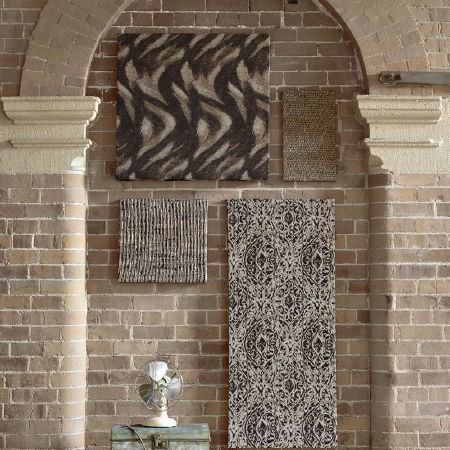 Kai -  Janco Fabric Collection - Two squares of brown ridged fabric, fabric which looks as though it has brown and black brush strokes, beige and black patterned fabric, fan