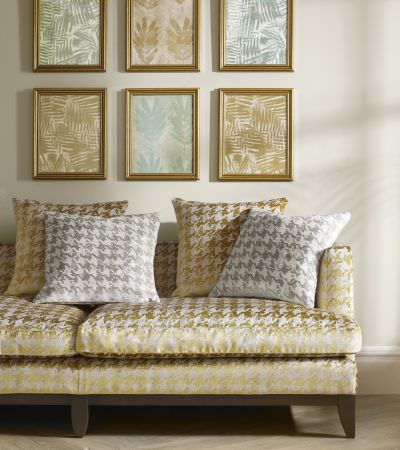 Kai -  Japura Fabric Collection - Upholstered sofa with modern gold pattern and matching pattern in gold and silver on cushions