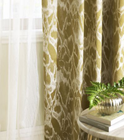 Kai -  Japura Fabric Collection - Very thin and transparent curtain in white covered by a gold curtain with white abstract design