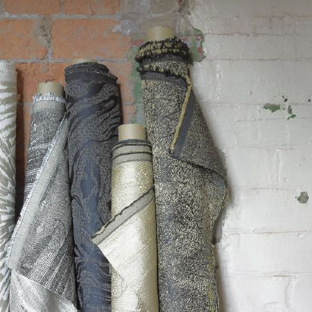 Kai -  Luminere Fabric Collection - Five rolls of slightly metallic dark grey, silver, light goldand grey speckled and swirled marble effect fabrics