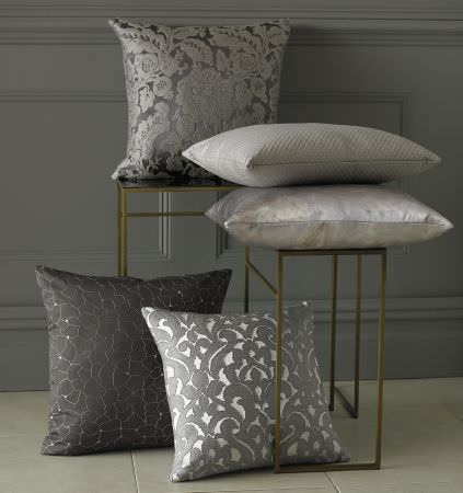 Kai -  Mahala Fabric Collection - A collection of cushions in different shades of grey decorated with modern decorative patterns