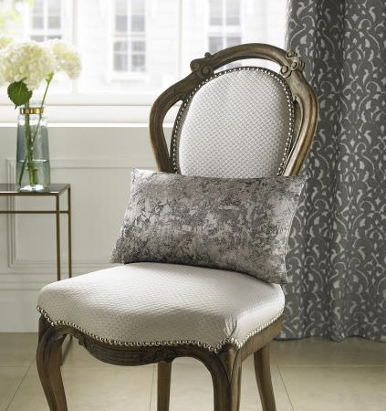 Kai -  Mahala Fabric Collection - Very elegant design on upholstered chair with wooden frame and elegant floral pattern on light grey curtain