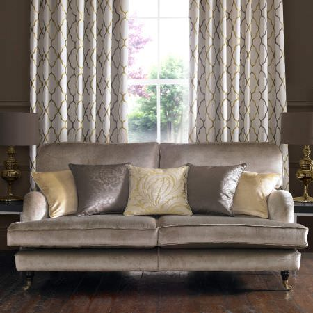 Kai -  Maurelle Fabric Collection - A rich, luxurious room with cushions, curtains and upholstery in colours of yellow, silver, gold and brown with ornate patterns