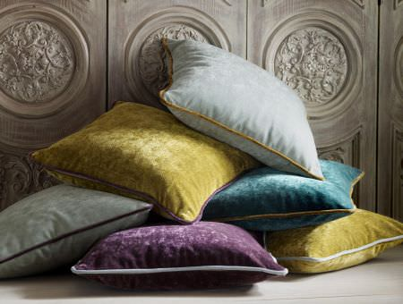 Kai -  Plush Fabric Collection - A collection of plush cushions in light blue, yellow, purple, turquoise and grey with edges in different colours