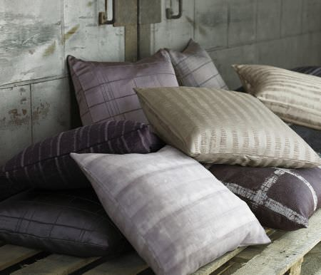Kai -  Starla Fabric Collection - Six scatter cushions made in dark and light shades of purple, with two cream cushions, all with subtle stripes or checks