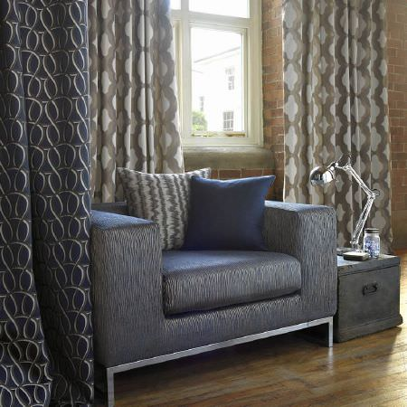 Kai -  Tsonga Fabric Collection - Large metallic effect blue and silver armchair, patterned curtains in blue and cream and brown and cream, two cushions, black trunk, lamp