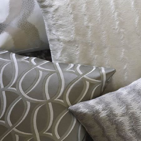 Kai -  Tsonga Fabric Collection - Silver cushion with embroidered grey and white loops, textured cushions with rough stripes in white and grey, and grey, beige, cream cushion