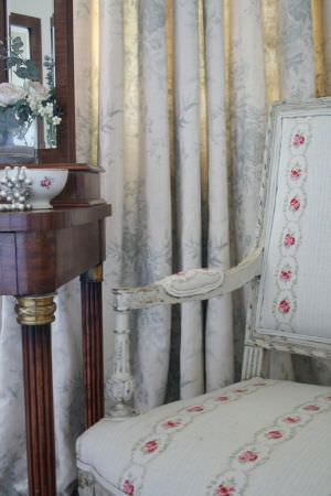 Kate Forman -  Kate Forman Fabric Collection - White curtain with classic faint floral impressions and a chair, lightly striped, with flower chains