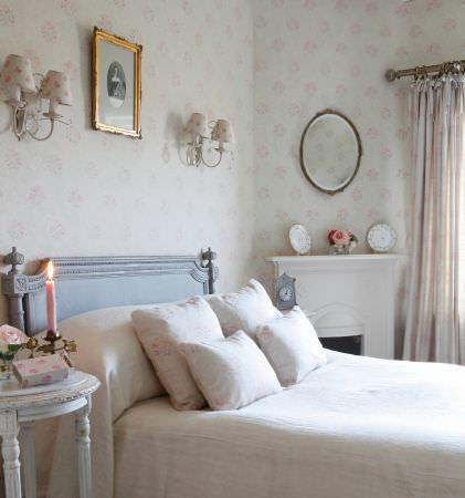 Kate Forman -  Kate Forman Fabric Collection - Plain white bedspread with white pillow covers with flowers and a white wall with light pink flower pattern