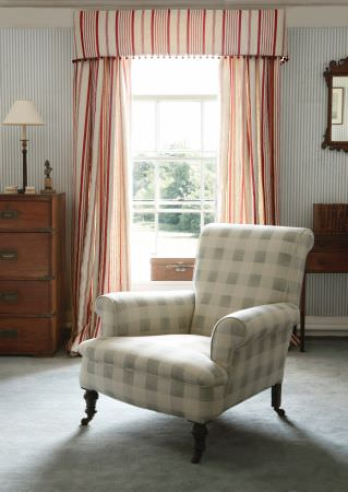 Kate Forman -  Kate Forman Fabric Collection - Red and white striped curtain valance behiind a white and grey plaid upholstered armchair perfect for a country house