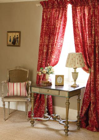 Kate Forman -  Kate Forman Fabric Collection - Vivid red pinched curtain with a classic white floral design, a white cushion with red stripes and a classic white lamp shade