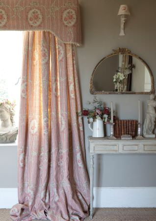 Kate Forman -  Kate Forman Fabric Collection - Red and white striped curtain and curtain pelmets with floral wreaths and flowers in the middle