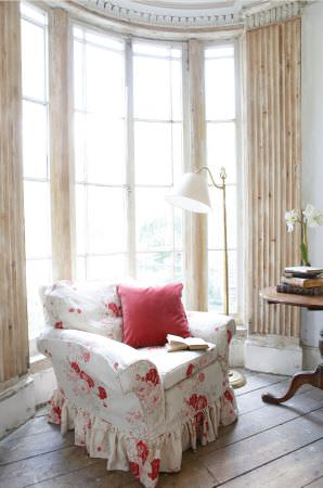 Kate Forman -  Kate Forman Fabric Collection - Classic type armchair with white upholstery decorated with detailed red and pink rose images and a plain red cushion