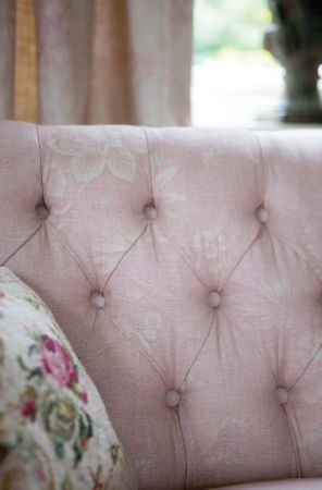 Kate Forman -  Kate Forman Fabric Collection - Close-up image of couch upholstery showing the detail of fabric and flower impressions