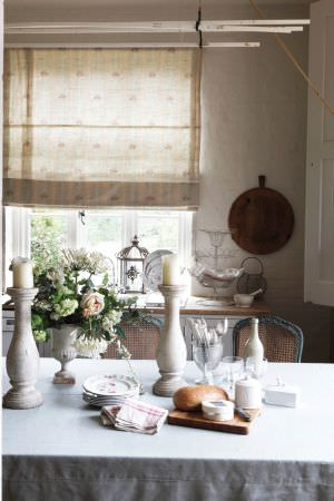 Kate Forman -  Kate Forman Fabric Collection - Cream white roman blinds with small flower decoration in kitchen area