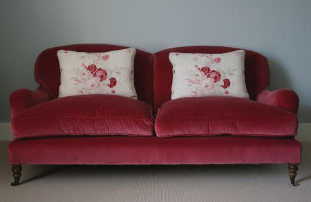 Kate Forman -  Kate Forman Fabric Collection - Classic couch with plain red upholstery and two white pillows with watercolour flower images