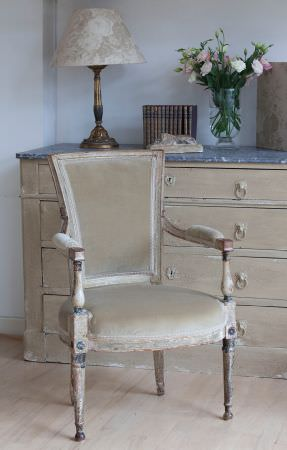 Kate Forman -  Kate Forman Fabric Collection - Antique upholstered armchair with plain sandy fabric and a sandy lamp shade with white flower impressions