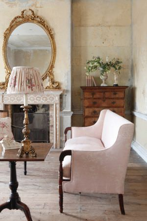 Kate Forman -  Kate Forman Fabric Collection - Antique bench/couch upholstered using light pink fabric with classic floral designs, and a classic pink lamp shade with flowers